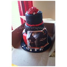 Booking release black and red cake