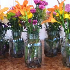 Flowers in mason jars with river rocks :)
