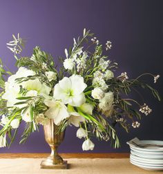 Winter bouquet: spreading branches (olive, Atlas cedar, magnolia, pine, or juniper), blossoms (amaryllis, magnolia, camellia, tulip) and berries (tallow, winterberry, privet, or holly). Some narcissuses added for fragrance.
