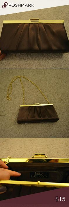 Jessica McClintock Brown and Gold Clutch Brown clutch with gold details. Gold chain can be removed. Only flaw is shown in last image, a very small bit of fabric is loose from the gold trim at top Jessica McClintock Bags Clutches & Wristlets