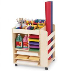 """Share art supplies among classes or move them from center-to-center for an art experience across curricula. This two-sided unit has a versatile shelving system, and the end area can be used to store rolls of paper or other large items. Heavy-duty casters, Baltic birch construction. Fully assembled (must attach casters). Measures  30""""H x 30""""W x 24""""D. Supplies sold separately."""