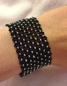 Netted Seed Bead Bracelet Black and silver plated seed beads with Swarovski Crys.Best Seed Bead Jewelry 2017 - Pattern from Off the Beaded P Beaded Cuff Bracelet, Seed Bead Bracelets, Seed Bead Jewelry, Seed Beads, Flower Bracelet, Jewelry Bracelets, Beaded Jewelry Designs, Jewelry Patterns, Bracelet Patterns
