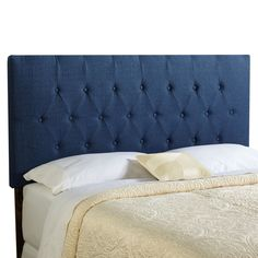The Halifax diamond tufted upholstered headboard is adjustable to accommodate a wide range of mattress heights. The fabric features a crosshatched texture in