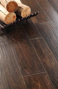 Once I saw this in person, I loved it! It looks like wood and even has a dimensional texture but it's ceramic! Extremely durable with kids, dogs, moving furniture around etc. I'd choose a darker grout though