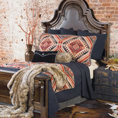 Tribal pillows and houndstooth bedskirt...Yes!