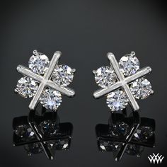 "XO Diamond Earrings Simply superb, the ""XO"" Diamond Earrings sparkle with 8 A CUT ABOVE® Hearts and Arrows Diamond Melee WANT THESE!!!!"