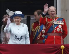 Britain's Queen Elizabeth II, accompanied by Prince Philip, wave to the crowds, on the balcony of Buckingham Palace, during the Trooping...