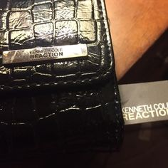 Kenneth Cole reaction clutch Brand new with tags Kenneth Cole clutch, no marks or scuffs never worn- black alligator skin Kenneth Cole Reaction Bags Clutches & Wristlets