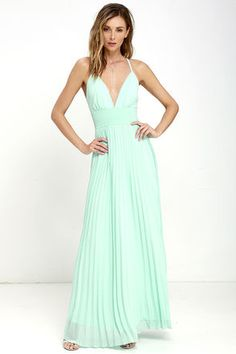 Deeper than the deep blue sea and the Grand Canyon combined ... that's how deep our love for the Depths of My Love Mint Maxi Dress is! Elegant chiffon in a lovely minty blue hue shapes a triangle bodice and sultry V neckline supported by crisscrossing, adjustable spaghetti straps. The fitted, pintucked waistline accentuates your figure before flowing into an accordion pleated maxi skirt. Hidden back zipper and clasp.