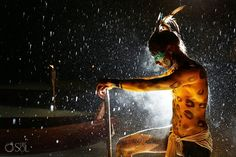 Modern Mayan warrior in the rain at the Travesia Sagrada Maya or Sacred Mayan Journey at @Xcaret Park   This is a culturally significant and gorgeous event, must see!  Photo by Juan Euan