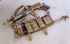 Eagle/SKD all MOLLE chest rig Blue Force Gear 10-speed pistol pouch for light and multi-tool CAT/Hemostats 3 x HSGI TACOs Diamondback Tactical double pistol pouch Gerber strap cutter pouch for cleaning rods QickClot guaze, kerlix, and a benchmade seatbelt cutter in the chest rig's main internal pocket