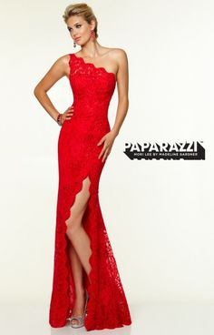Lovely in lace, this stunning Paparazzi 97112 gown is a one-of-a-kind beauty. We love the classic, one-shoulder sleeve, flattering fit, sexy thigh-high slit, and sexy allure. You will love wearing this gown to prom, a black tie affair, military ball, or formal gala.