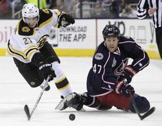 The Bruins' Loui Eriksson (left) and the Blue Jackets' Dalton Prout chase a loose puck during the first period. Jay LaPrete/Associated Press