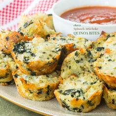 Cheesy Spinach Artichoke Quinoa Bites turn hot spinach artichoke dip into a healthy, whole grain finger food for an easy appetizer or snack.Recipe here!