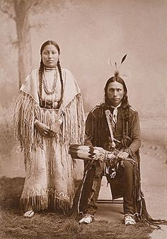 An old photograph of an Arapaho Couple.