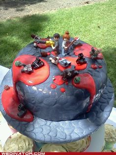 It took me a second to see that this was a zombie killing cake! HAHAHAHA!! Can we say groom's cake?!