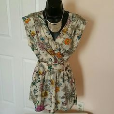 Floral H&M romper V-neck, with attached tassel belt that ties in the back.  Side zip. H&M Shorts