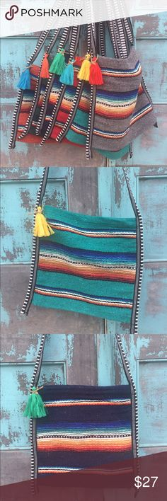 Serape Crossbody Bag Authentic Serape fabric in a cute crossbody.  These bags are made from serape blanket fabric made in Mexico so they are thick and durable.  They are approximately 12x12. Bags Crossbody Bags