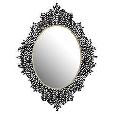 """Aluminum wall mirror with a floral motif and scrolling garland silhouette.  Product: MirrorConstruction Material: High-gloss aluminum and mirrored glassColor: Black and whiteFeatures:  UV-Resistant coatingDesigned by Julia Da Rocha for DENY Designs Dimensions: Small: 19"""" H x 14"""" W x 1"""" DMedium: 29"""" H x 22"""" W x 1"""" DLarge: 38"""" H x 30"""" W x 1"""" D"""