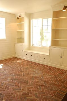 Built-ins, lighting, worn brick herringbone floor; http://www.generalshale.com/products/thin%20brick/
