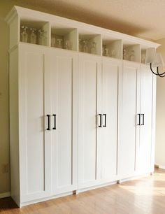 You've GOT to check out this blog. High end looking DIYs at budget prices. Tutorial on how to build a custom-looking storage cabinet from inexpensive assembled kitchen pantries.