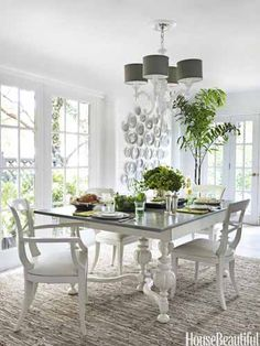 Light and bright dining room. Design: Zim Loy. housebeautiful.com. #dining_room #white #high_gloss #chandelier