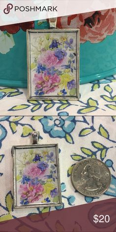 "Floral nature painting pendant necklace silver Adorn yourself in the beauty of nature with this gorgeous floral pendant necklace. Image is from Marjolein Bastin. String it on a chain to wear as a necklace, or add it to your keyring for some extra flair. Brand is Totally Twitterpated--listed Anthro for exposure.  ❤️Glossy finish ❤️Antiqued silvertone pendant ❤️Measures 25mm x 35mm (approx. 1"" x 1.5"") ❤️Pendant only; chain NOT included ❤️Makes a unique gift! ❤️Price is firm unless bundled…"