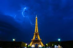 Photo Thunderstorms behind Eiffel Tower at night by Ionut David on 500px