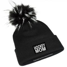 "Soft black knit acrylic toque with a fabric patch printed with Hockey Mom DETAILS: Black acrylic toque (11"" total length) with cuff Black fabric patch sewn onto the hat Graphic Hockey Mom available in"