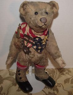 Adorable Antique Mohair Long Snout Bear With Old Pendants On A Flag Scarf 13 1/2 Tall Circa 1900's