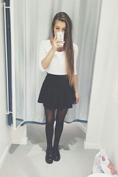 Lovely outfit and long brunette hair.
