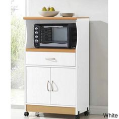 @Overstock - Microwave Cart Stand - Keep your kitchen organized with this clean yet stylish Microwave Cart Stand in two finish options. This stand features one shelf in the middle for microwave and one shelf on the top for small appliances.  http://www.overstock.com/Home-Garden/Microwave-Cart-Stand/9046322/product.html?CID=214117 $99.99