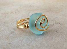 Hey, I found this really awesome Etsy listing at http://www.etsy.com/listing/126595594/ocean-blue-sea-glass-ring-24k-gold