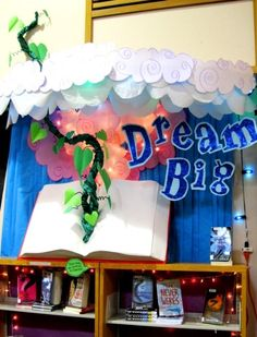 """Dream Big"" is a great title for a library book display that features fantasy books. Rachel Moani's idea of having a beanstalk growing out of a book is very creative! awesome school ideas,Classroom Bulletin Board Ideas,C Reading Display, Library Book Displays, Class Displays, Library Books, Library Ideas, Dream Library, Bfg Display, Teaching Displays, Library Corner"