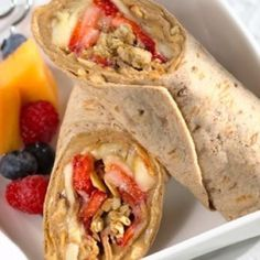 Strawberries bananas peanut butter and granola on low fat wrap!  Love peanut butter and pear wraps! www.WowFoodTips.com