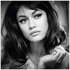 Olga Kurylenko, by Anton Corbijn. Love the thick but manicured brows and mondo wing.
