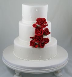 Simple Fondant Wedding Cake, swiss dot piping and red sugar roses. #WeddingCakes, #SugarFlowers, #SpecialEventCakes,