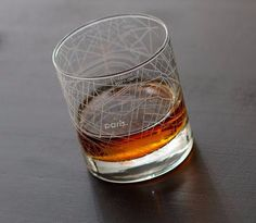 A rocks glass with a street map of Paris.
