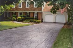 Concrete driveway cost depends on many different things. I'll answer the question what is the cost of a concrete driveway and explain why a cement driveway cost more than an asphalt driveway. Cost Of Concrete Driveway, Concrete Driveway Resurfacing, Stone Driveway, Driveway Design, Driveway Ideas, Patio Ideas, Yard Ideas, Stamped Concrete Walkway, Concrete Yard