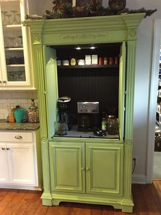 Entertainment center painted and converted into a coffee and tea bar. Great pop of green in a white kitchen. #Decoratingkitchen