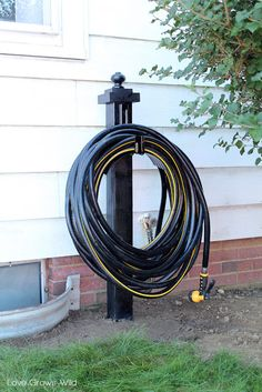 LoveGrowsWild.com | Make this DIY Garden Hose Holder to add great curb appeal to your home! #diy #garden # home