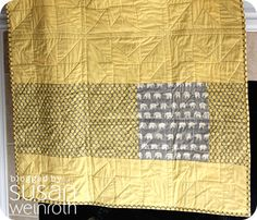 Yellow and grey baby quilt with elephants