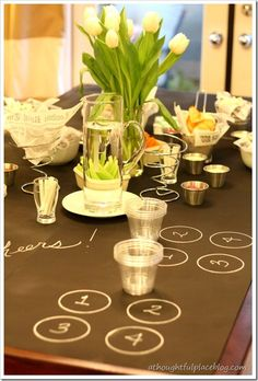 Whether a DIY chalkboard tablecloth or a chalkboard paint table topper, the party ideas are almost limitless and ageless - from kids party to wine tasting to game night pictionary!!!