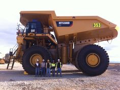 The new Cat MT5300 mining truck up at Kennocott. It is 28 ft tall, 33 ft long, can haul 325 tons, and weighs 72,100 lbs.