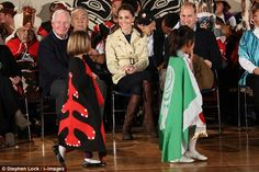 The duchess looked delighted as she watched the performance by young schoolchildren from t...