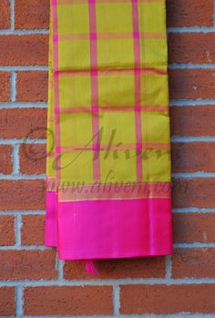 Mustard Yellow Kuppadam Saree with Pink checks and Pink Borders