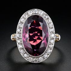 Raspberry Tourmaline and diamond ring - elongated oval pink tourmaline, 6.15 carats; 24 single cut diamonds 0.50 ctw I-K color and 6 rose cut diamonds, 0.50 ctw. Platinum and 14kt yellow gold. Circa 1900