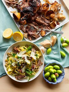 Slow-cooked lamb pappardelle with green olives and almonds
