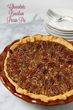 Chocolate Bourbon Pecan Pie from CookingInStilettos.com is a delicious dessert for your holiday table. Dark chocolate melds with sugar, pecans and a hint of bourbon - what's not to love? #BloggerCLUE Chocolate Bourbon Pecan Pie, Pie Dish, Pie Dessert, Corn Syrup, Yummy Cakes, Vanilla Whipped Cream, Pecans, Fun Desserts, Pie Recipes