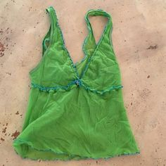 Adorable mesh Cami Beautiful lime and blue mesh Cami only worn once or twice. Has a cute rosette in center of vee. Tops Camisoles